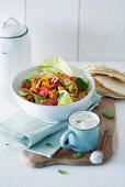 Spicy chicken and vegetable salad with peppermint and yoghurt sauce