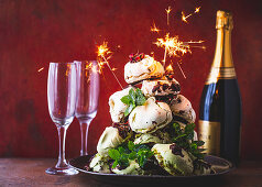 A meringue Christmas tree for Christmas decorated with sparklers
