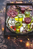 Festive lime and raspberry jelly with gin and edible flowers
