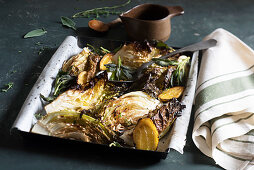 Oven-roasted Savoy cabbage with honey, pine nuts, lemon and crispy sage