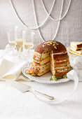Spicy Panettone sandwich cake with salmon, tuna and cucumber