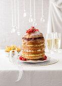 Panettone cake with vanilla cream, chocolate, raspberries and pears