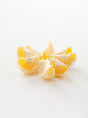 Mandarin segments on a white surface