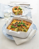 Bread casserole with sausage and broccoletto