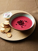 Cream of beetroot and Savoy cabbage soup with bread crisps and sour cream