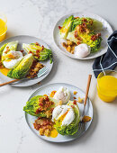 Breakfast salad with poached eggs and bacon croutons
