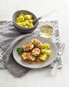 Monk fish in a white wine and vegetables sauce with parsley potatoes