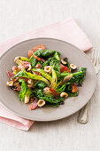 Steamed spinach with ham and hazelnuts