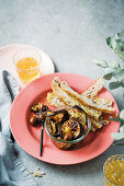 Marinated brinjal and olive bowl with melba toast