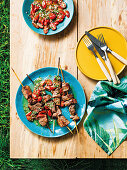 Salt-rubbed steak skewers with gremolata tomatoes