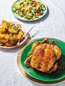 Moroccan roast chicken with grain salad and roasted potatoes