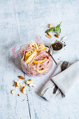 Pink glass noodle salad with omelette rolls