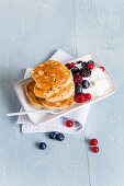 Protein pancakes served with quark and berries