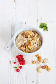 Vegan porridge with banana and chopped nuts