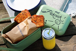 Tuna fish cake in a lunch box for a picnic by a lake