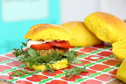 Veggie burgers with chickpea patties, tomato and rocket