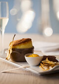 Pear soufflé with apricot sauce and pear chips