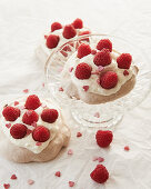 Pavlovas with raspberries and sugar hearts for Valentine's Day