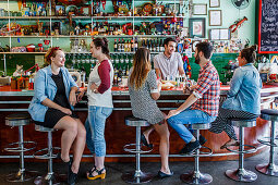 People in 60s diner restaurant