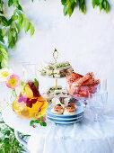 White Sangria, smoked caviar bites, prawns, sandwiches