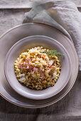 Fusilli lunghi with Jerusalem artichoke sauce and stripes of mortadella