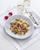 Ravioli in cheese sauce with mushrooms and chestnuts