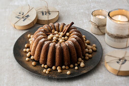 Spiced apple cake with marzipan balls and cinnamon