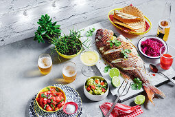 Pez rostizado (roasted whole fish) with pickled red cabbage and pico de gallo