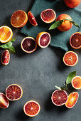 Halved blood oranges with leaves