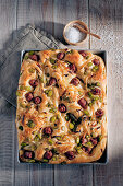 Focaccia with fava beans, onions and salsiccia
