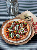 Pizza with vegetables and sardines