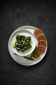 Wild garlic pesto and black bread crackers