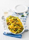 Saffron reginette with salsiccia and green asparagus