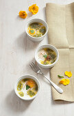Oeuf cocotte with anchovy butter