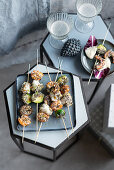 Fish and shrimp kebabs with brussels sprouts
