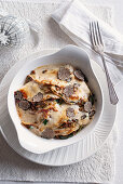 Gratin crepes with lentil filling and black truffle