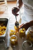 Filling Mostarda mantovana in glasses (mustard fruit, Italy)