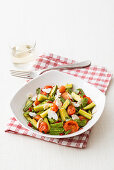 Spicy zucchini and tomato vegetables with ricotta