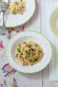 Carbonara with cooked ham and peas