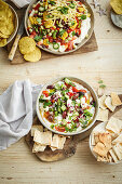 Loaded mexican dip and Loaded greek-style dip