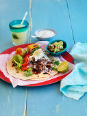 Texmex tortillia with pulled beef, corn, coriander, lime, guacamole, sour cream and cheese