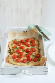 Rustic pizza with mozzarella and cherry tomatoes