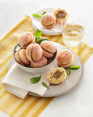 Pesche dolci all'alchermes (sandwich biscuits with chocolate cream and herb liqueur, Italy)