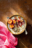 Porridge with plums, pecan nuts and pomegranate