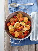 Ricotta fritters filled with anchovies on steamed tomatoes