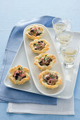 Mushroom and cheese tartlets with ham