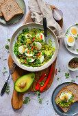 Salad with avocado eggs coriander and chilli