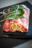 Ready-to-roast pork filled with dried figs and sage
