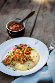 Polenta with meat sauce and chanterelle mushrooms