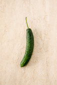 A cucumber on a stone surface